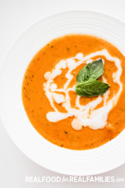 This plant based tomato basil soup is creamy and packed with vegetables. It is delicious and something your family will ask you to make on repeat!